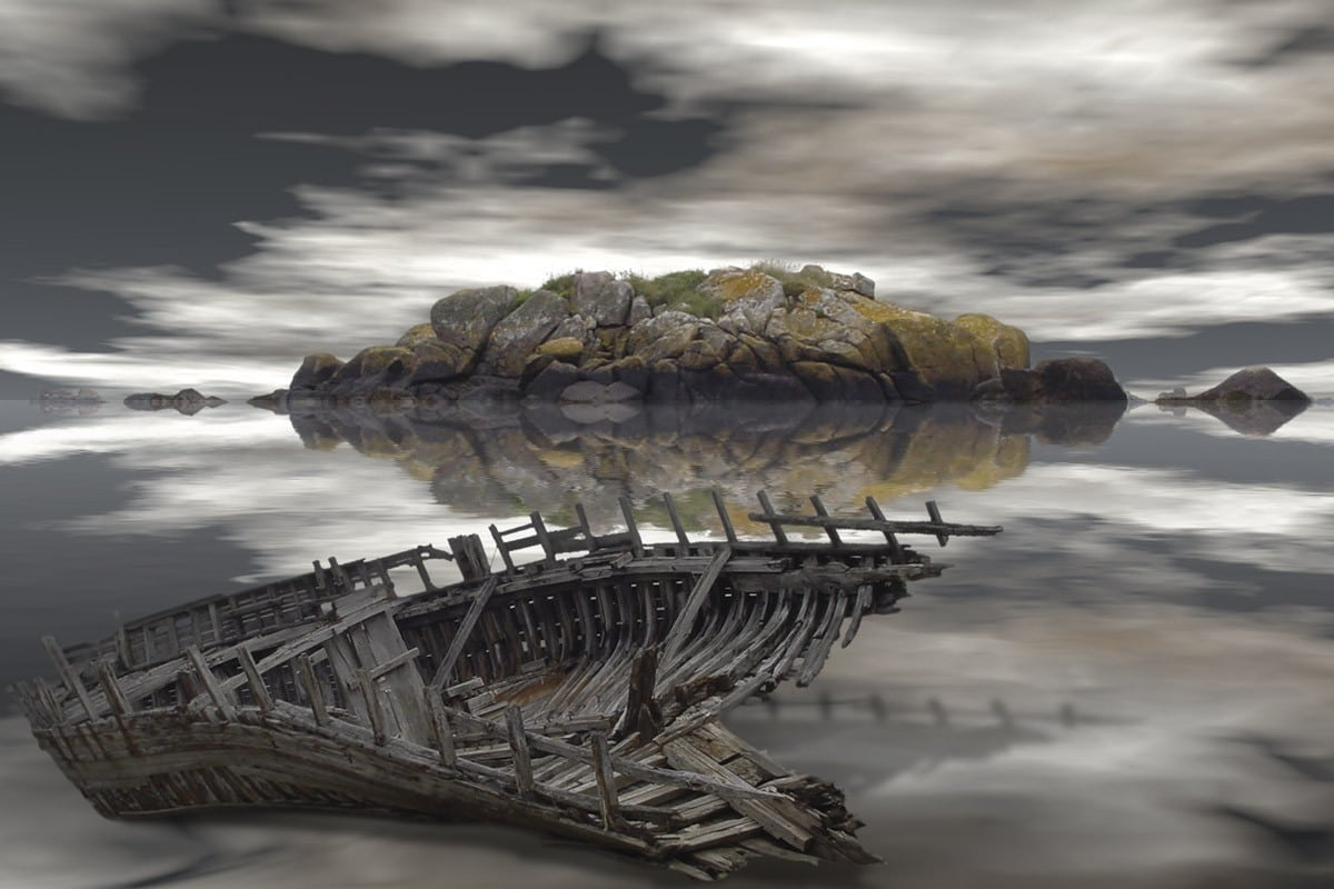Abandoned boat along a rugged coastline. Surreal Photo Art